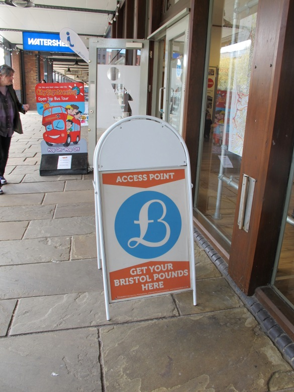 Get your bristol Pound here! Exchange places are normally also shops which accept it. I bought them at the tourist info