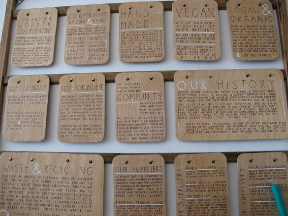wooden plates on the wall of Cafe Kino inform about their history and philosophy